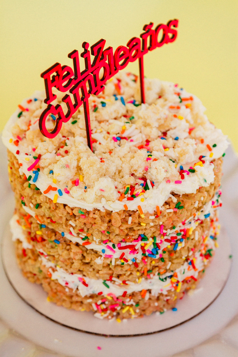 Funfetti Rice Krispie Naked Cake with Feliz Cumpleanos sign